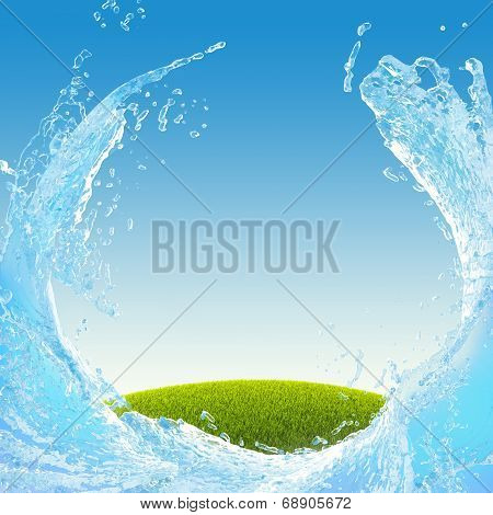 Green meadow and water splash