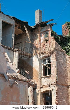 old partially collapsed house
