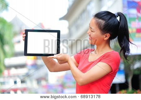 young asian woman hold blank digital tablet on shopping street