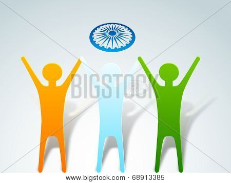 Indian Independence Day celebrations concept with people in national tricolors with Asoka wheel on grey background.