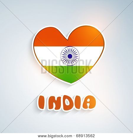 Beautiful heart shape in national tricolors with Asoka wheel and stylish text India on grey background for Indian Independence Day celebrations.
