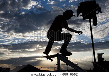 Silhouette of skateboarder doing a stunt