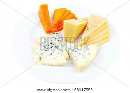 fresh aged french cheese parmesan roquefort and gruyere chops with slices on plate with isolated over white background