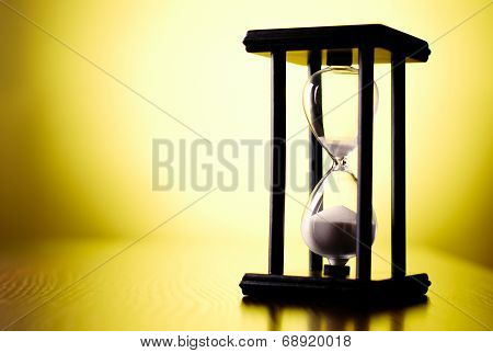 Egg Timer Or Hourglass On A Yellow Background