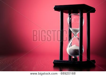 Egg Timer Or Hourglass On A Red Background