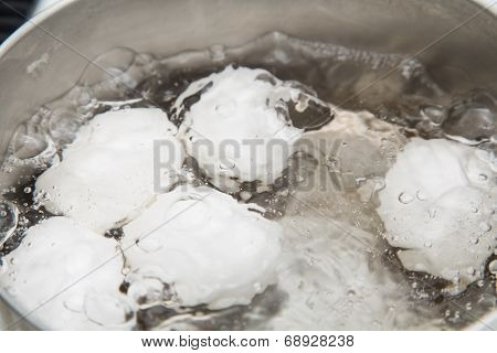 Eggs In Boiling Water
