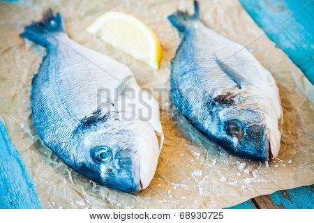 Two Raw Dorada Fishes With Lemon