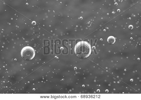 Air Bubbles In A Liquid. Abstract Black-and-white Background. Macro