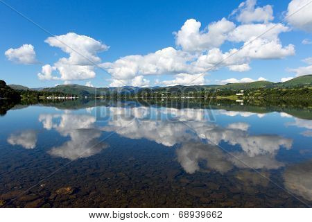 Lake District Cumbria England UK Ullswater with mountains and blue sky on beautiful still summer day