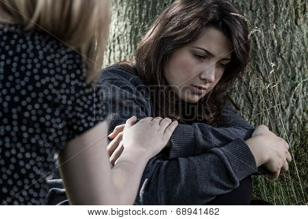Woman Comforting Her Sad Friend
