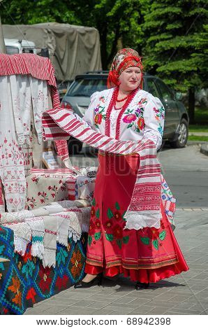 Belarusian Woman In A Suit With An Unwrapped Towel In Hand