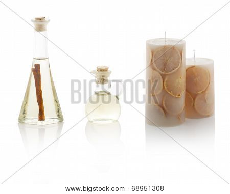 Spa Oils In Bottles And Scented Candles. With Ps Paths.