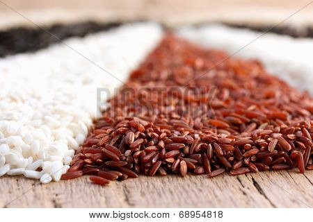 different types of rice on the old wooden table
