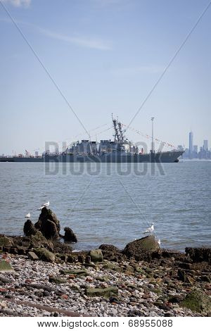 STATEN ISLAND, NY - MAY 25, 2014: The guided-missile destroyer USS Cole (DDG 067) moored at Sullivans Piers with the Freedom Tower and NYC skyline in the background on May 25, 2014.