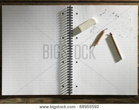 Blank Pad of Paper, Eraser and Broken Pencil