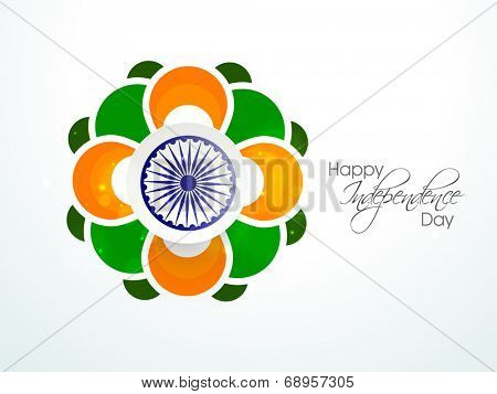 Beautiful floral design in national tricolors with Asoka Wheel for Indian Independence Day celebrations.