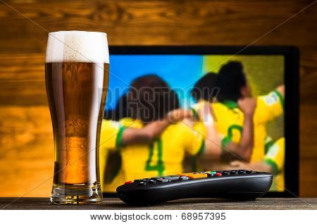 Glass Of Beer And Tv Remote, Football Match In Background