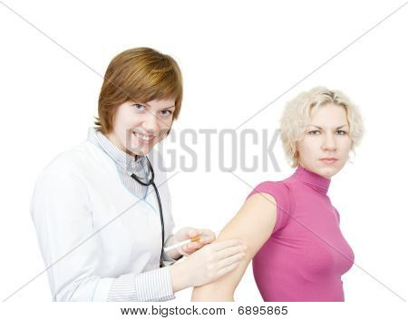 Doctor Giving A Girl An Intramuscular Injection