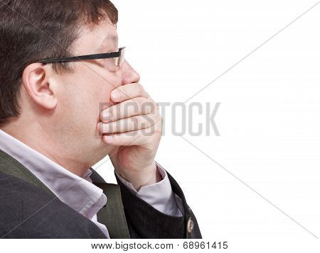 Businessman's Hand Closing Mouth