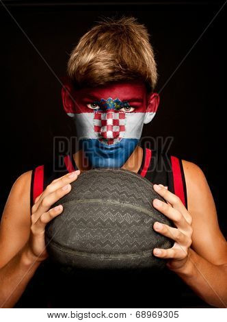 portrait of basketball player with croatian flag painted on his face