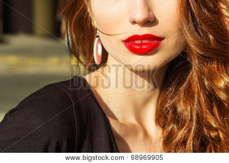 beautiful young sexy girl with makeup with enticing the big red lips and long hair in a Sunny summer