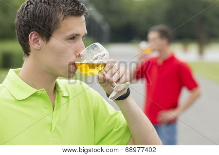 Young Student Drinking Something