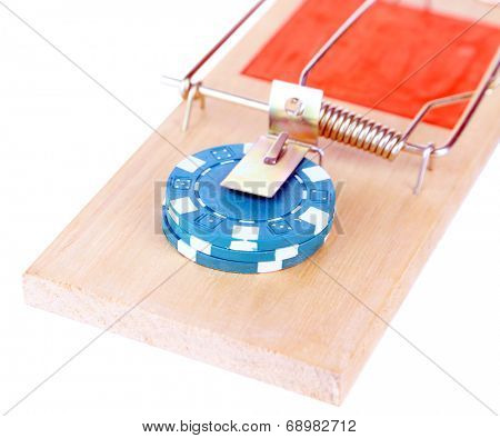 Mousetrap and casino chip isolated on white