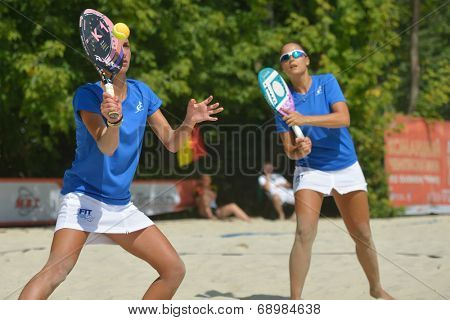 MOSCOW, RUSSIA - JULY 18, 2014: Woman double of Italy in the match against France during ITF Beach Tennis World Team Championship. Italy won in two sets