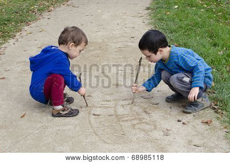 Children Drawing Into Sand