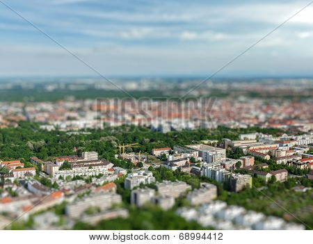 Aerial view of Munich from Olympiaturm (Olympic Tower) with tilt shift toy effect shallow depth of field. Munich, Bavaria, Germany