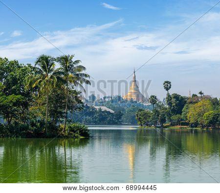 Travel Myanmar tourism background - view of  Shwedagon Pagoda over Kandawgyi Lake in Yangon, Burma (Myanmar)