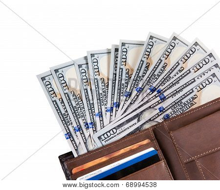 Wallet filled with many United States one hundred dollar Federal Reserve notes