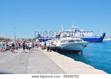 CORFU, GREECE - JUNE 23, 2014: Joy Cruises hydrofoil Ilida II disembarks passengers from Paxos at Kerkira harbour on the Greek island of Corfu. The 35mtr long vessel was built in Georgia in 1982.