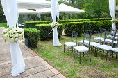 picture of marquee  - a wedding marquee with bouquets of roses - JPG