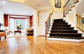 picture of entryway  - Open entryway with wood floor and staircase with view of living room - JPG