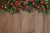 stock photo of mistletoe  - Christmas background border with red bell baubles - JPG