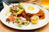foto of wieners  - Wiener Schnitzel with Potatoes and Fresh Vegetables - JPG