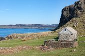image of bute  - Traditional stone house by the sea on the Isle of Mull Inner Hebrides of Scotland - JPG