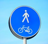 picture of street-walker  - a blue pedestrian and bike lane sign - JPG