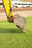 pic of power-shovel  - A huge shovel digging on green grass - JPG