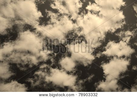 ark blue sky with clouds sepia