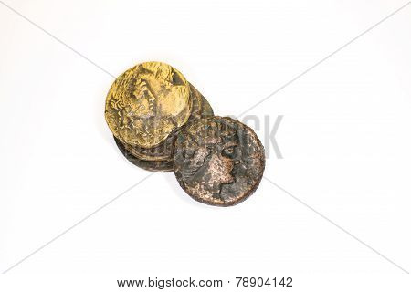 Four Ancient Coins On White Background