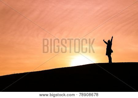 Woman Throwing Her Arms In The Air