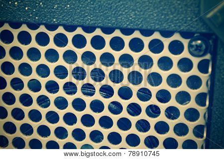Close Up Of A Guitar Amplifier Grill In Vintage Tone