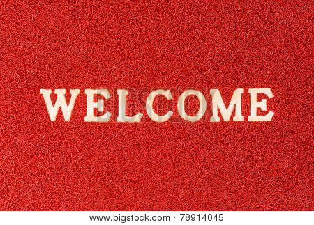 Red Doormat And Welcome Text