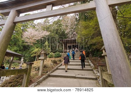 YOSHINO, JAPAN - April 17th : Tourists walking toward Kimpu Shrine, Yoshino, Nara, Japan on April 17th, 2014. Kimpu Shrine was  UNESCO World Heritage Site in Japan.