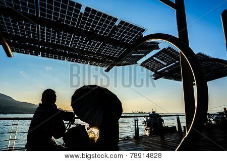 TAIPEI, TAIWAN - November 21th : The Sunset and people silhouette in the pier of Tamsui, Taiwan on November 21th, 2014.