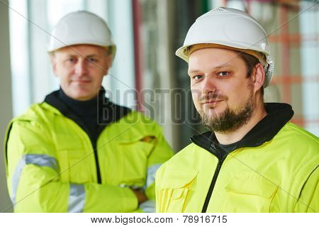 young male construction engeneer worker project manager at a indoors building site