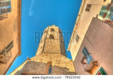 Alghero Duomo Steeple Under A Blue Sky