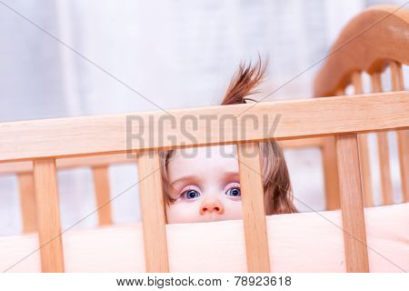 Little Girl Standing In The Crib
